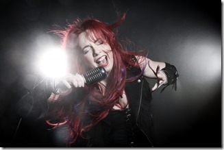WICKED%20PLAN%20promo%20-%2001a%20Natali%20vocals%20with%20microphone%20(Y62A8316)